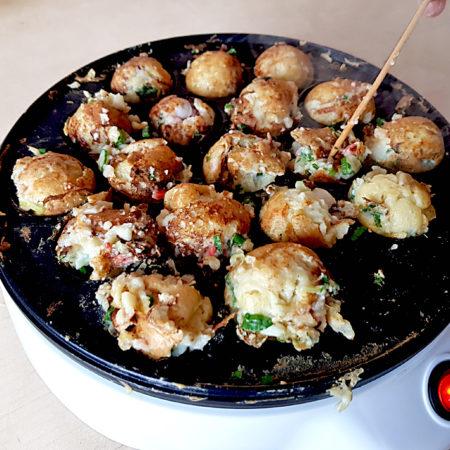 Takoyaki nehmen langsam Form an