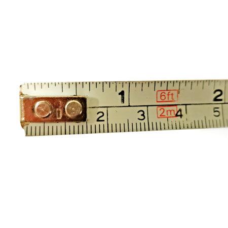 Maßband mit Zentimetern und Inches